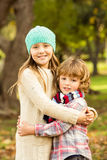 Happy siblings in the park Stock Images