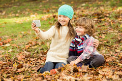 Happy siblings in the park. On an autumns day Royalty Free Stock Photography