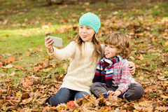 Happy siblings in the park Royalty Free Stock Images