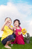 Happy siblings playing outdoor at summer Royalty Free Stock Photos