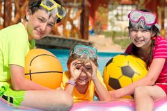 Happy siblings in the pool Stock Photos