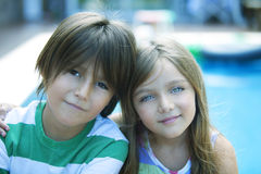 Happy siblings portrait. Happy little siblings smiling outdoors royalty free stock photo