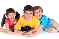 Happy siblings with puppy. Studio portrait of happy smiling siblings with their puppy stock image