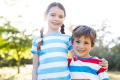 Happy siblings smiling at camera Royalty Free Stock Image