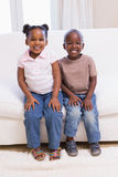 Happy siblings smiling at camera together Royalty Free Stock Photography