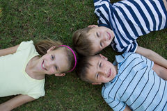 Happy siblings smiling at camera together Stock Photography