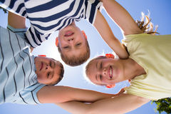 Happy siblings smiling at camera together Stock Photo