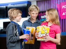 Happy Siblings With Snacks At Cinema Royalty Free Stock Images