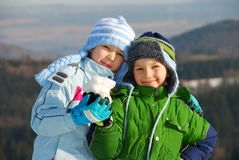 Happy siblings with snow. In their hands stock photos