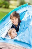 Happy Siblings In Tent Royalty Free Stock Photography