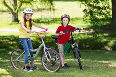 Happy siblings on their bike Royalty Free Stock Photography