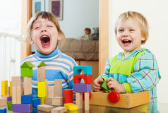 Happy  siblings together playing with blocks Stock Photo