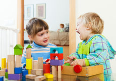 Happy  siblings together playing in home Stock Photos