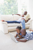 Happy siblings using their laptop Royalty Free Stock Photography
