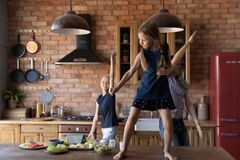 Free Happy Sick Mother, Father And Little Daughter Dancing In Kitchen Royalty Free Stock Images - 204635429