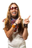 Happy and silly man pointing up at copyspace. Happy and silly man dressed like a hippie pointing up at copyspace. Isolated on white royalty free stock images
