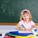 Happy similing children student girl at school. Happy similing student girl at school classroom Royalty Free Stock Photography