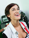 Happy Singer Looking Up In Recording Studio Stock Photography