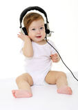 Happy singing baby with black headphones Royalty Free Stock Image