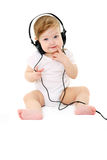 Happy singing baby with black headphones Stock Photo