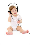 Happy singing baby wearing big black headphones Stock Image