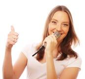 Happy singing girl. Stock Photo