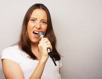 Happy singing girl. Stock Photos