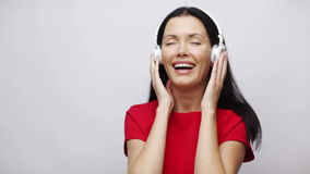 Happy singing girl with headphones Royalty Free Stock Photography