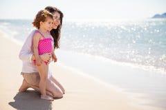 Happy single mom at the beach Stock Image