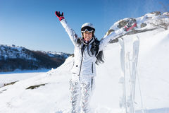 Happy single skier in spray of snow Royalty Free Stock Images