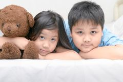 Sister and brether lying on bed. Happy sister and brether lying on bed Stock Image