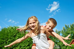 Happy Sister and Brother outdoor Stock Photos