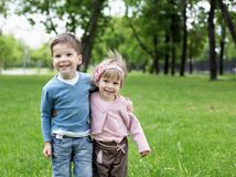 Happy sister and brother outdoors Stock Images
