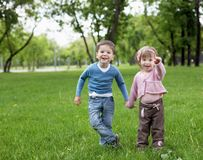 Happy sister and brother outdoors Royalty Free Stock Images