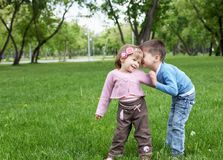 Happy sister and brother outdoors Stock Image