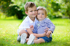 Happy sister and brother together in the park Royalty Free Stock Photo