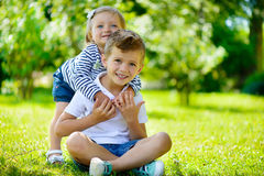 Happy sister and brother together in park Royalty Free Stock Images