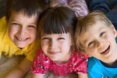 Happy sister and brothers royalty free stock image