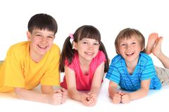 Happy sister and brothers. Happy young sisters and brothers lying on white studio background Stock Image