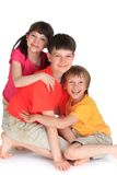Happy sister with brothers. Colorful portrait of happy sister with brothers on a white background Stock Photos