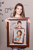 Happy sister holding portrait with her family Royalty Free Stock Photography