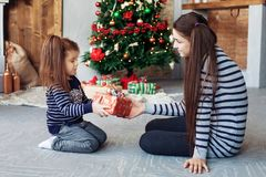 happy sister unpack gifts for Christmas. The concept of Christmas and New Year. royalty free stock photos