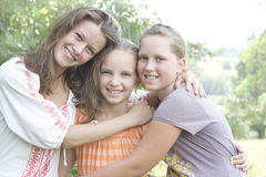 Happy sisters. Happy teens girls outside together stock photo