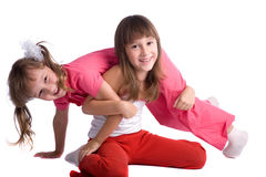 Happy  sisters. Happy smiling little sisters on white background Royalty Free Stock Images