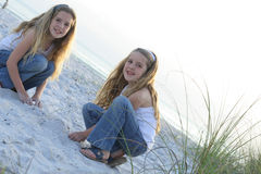 Happy sisters at the beach Stock Images