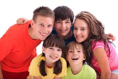 Happy sisters and brothers. Portrait of two three happy young brothers and two sisters in colorful clothing; isolated on white background stock photography