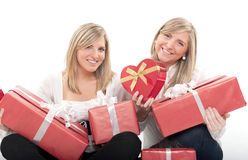 Happy sisters with gifts Stock Photos