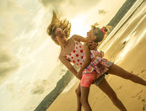 Happy sisters having beach fun Stock Photos