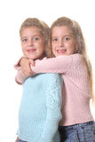 Happy sisters hug vertical on white Stock Photography
