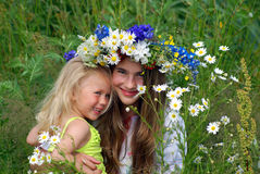 Happy sisters on nature Royalty Free Stock Images